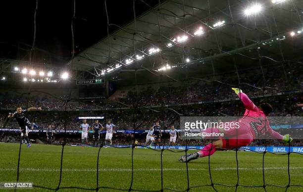 Melbourne City goalkeeper Dean Bouzanis saves a penalty kick from Besart Berisha of the Victory during the round 18 ALeague match between Melbourne...