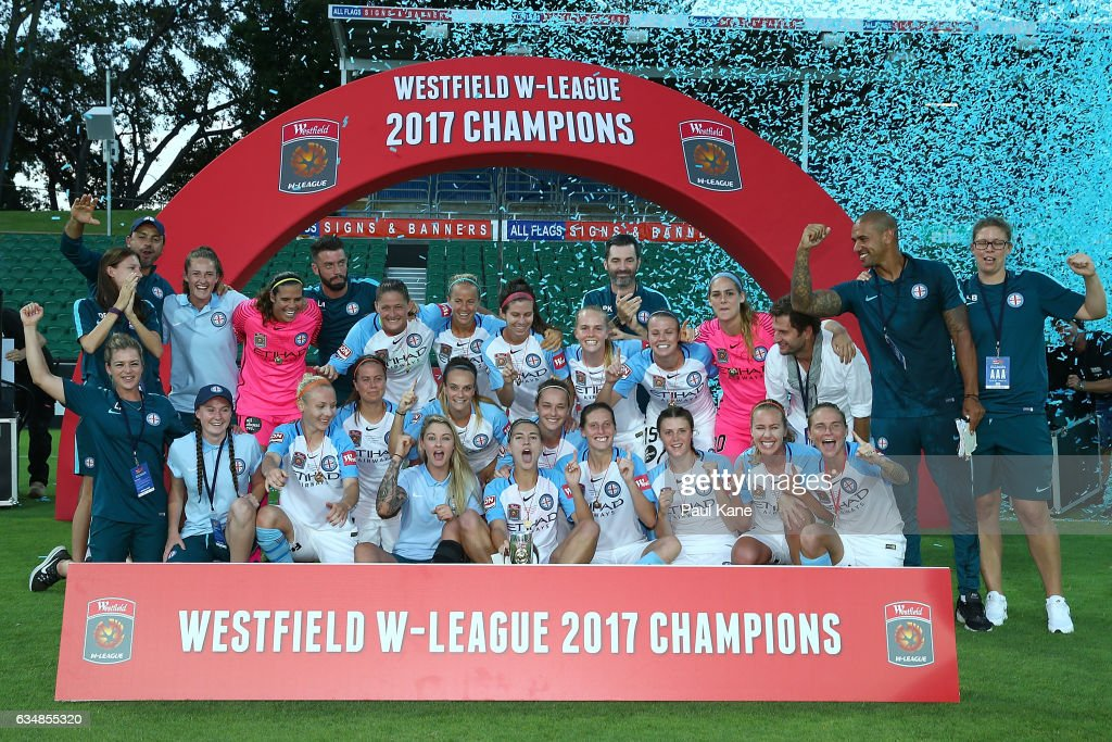 Melbourne City players and coaches pose with the trophy after winning the 2017 W-League Grand Final match between the Perth Glory and Melbourne City FC at nib Stadium on February 12, 2017 in Perth, Australia.