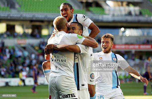 Melbourne City players celebrate with Aaron Mooy following his goal during the round 13 ALeague match between Melbourne City FC and Perth Glory at...