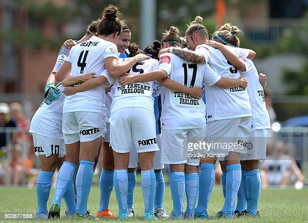 Melbourne City players embrace before the round 11 WLeague match between Brisbane Roar and Melbourne City FC at the Broadbeach Soccer Club on...
