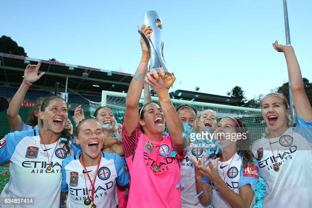Melbourne City players pose with the trophy after winning the 2017 WLeague Grand Final match between the Perth Glory and Melbourne City FC at nib...