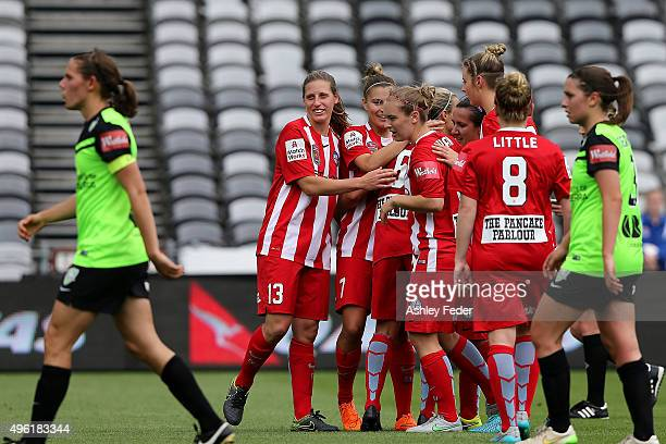 Melbourne City team mates celebrate a goal with Canberra United looking dejected in frame during the round four WLeague match between Canberra United...
