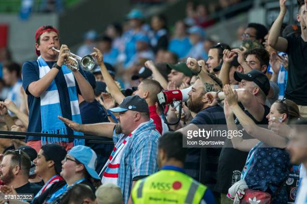 Melbourne Citysupporter with a trumpet works the crowd into a frenzy during Round 6 of the Hyundai ALeague Series between Melbourne City and the...