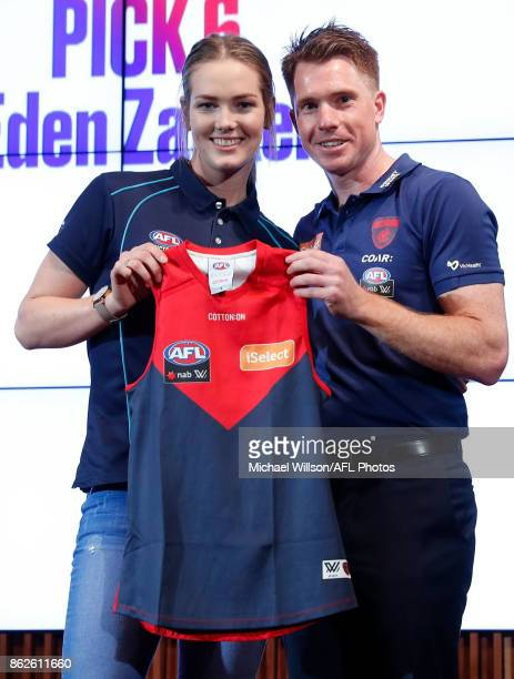 Melbourne Coach Mick Stinear poses for a photo with Eden Zanker during the 2017 NAB AFL Women's Draft at Docklands on October 18 2017 in Melbourne...