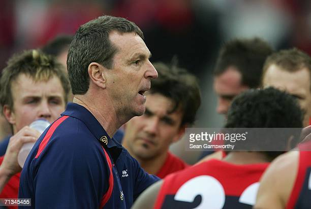 Melbourne coach Neale Daniher addresses his players during the round 13 AFL match between Melbourne and Port Adelaide at the Melbourne Cricket Ground...