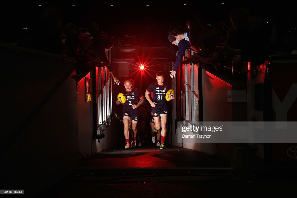 Melbourne cocaptains Nathan Jones and Jack Grimes lead the team out for warm up before the round 14 AFL match between the Melbourne Demons and the...