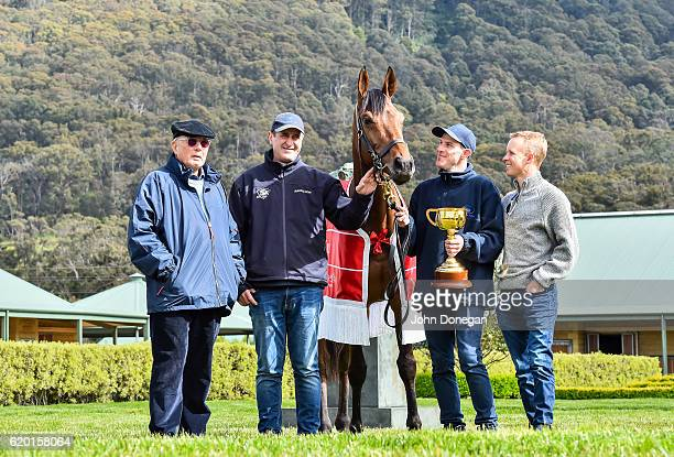 Melbourne Cup winner Almandin poses with part owner Lloyd Williams trainer Robert Hickmott strapper Joel Flannery and jockey Kieran McKevoy at...