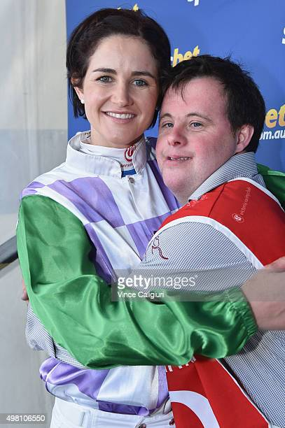 Melbourne Cup winning jockey Michelle Payne poses with brother and strapper Stephen Payne after signing autographs and posing with fans during...