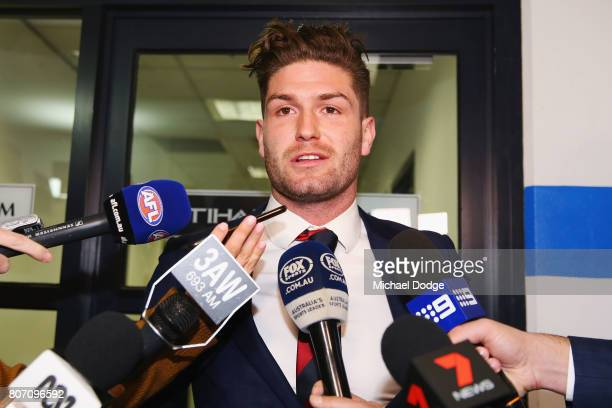 Melbourne Demons AFL player Tom Bugg makes a statement after receiving a six week suspension for striking Sydney's Callum Mills the AFL Tribunal at...