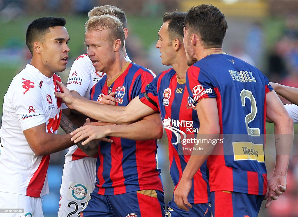 Melbourne Heart and Newcastle Jets players are involved in a scuffle during the round seven A-League match between the Newcastle Jets and the Melbourne Heart at Hunter Stadium on November 24, 2013 in Newcastle, Australia.