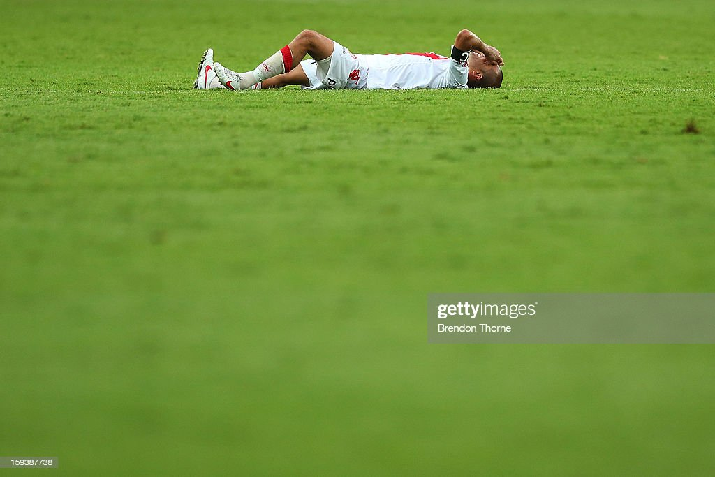 Melbourne Heart captain, Fred lies on the ground in dejection at full time following the round 16 A-League match between Sydney FC and the Melbourne Heart at Allianz Stadium on January 13, 2013 in Sydney, Australia.