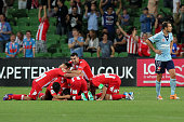 Melbourne Heart players celebrate David Williams goal during the round 17 ALeague match between Melbourne Heart and Sydney FC at AAMI Park on January...