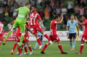 Melbourne Heart players celebrate their win against Sydney FC during the round 17 ALeague match between Melbourne Heart and Sydney FC at AAMI Park on...