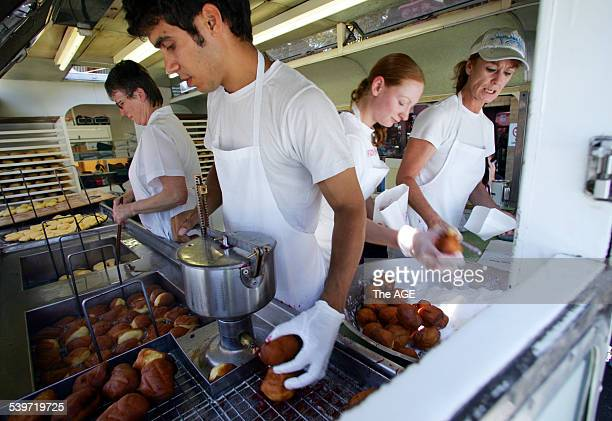 Melbourne icons American Doughnut kitchen at Queen Victoria Market Janet Murray right with her team in the famous caravan THE AGE Picture by VINCE...