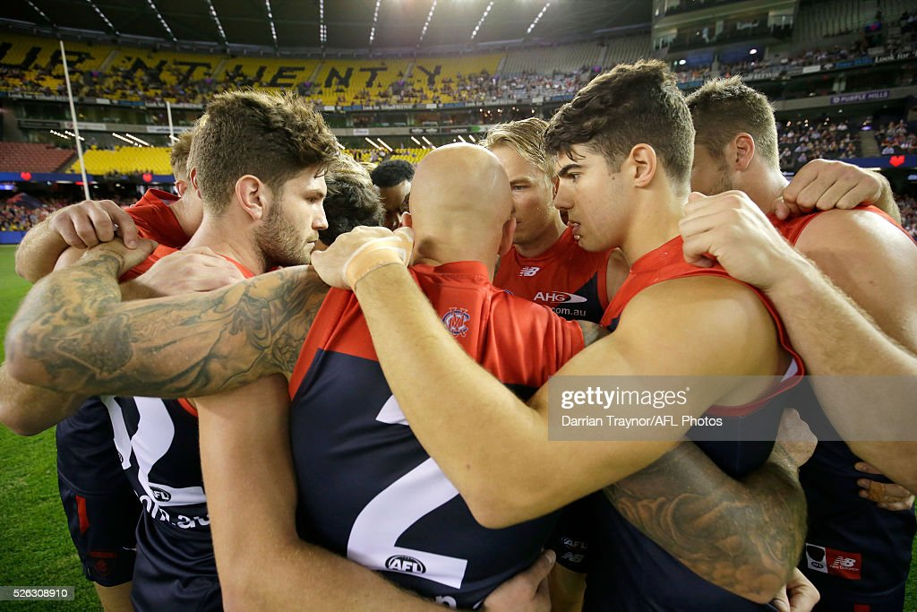 Melbourne players huddle up before during the round six AFL match between the Melbourne Demons and the St Kilda Saints at Etihad Stadium on April 30, 2016 in Melbourne, Australia.