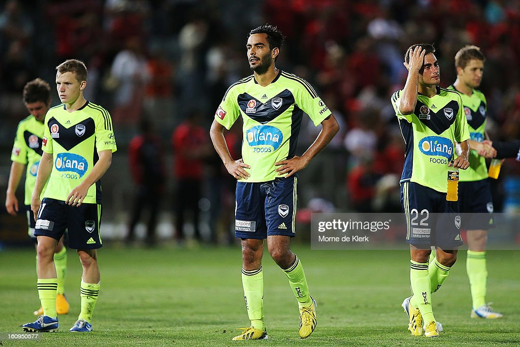 Melbourne players including Marcos Flores (C) react after the round 20 A-League match between Adelaide United and the Melbourne Victory at Hindmarsh Stadium on February 8, 2013 in Adelaide, Australia.