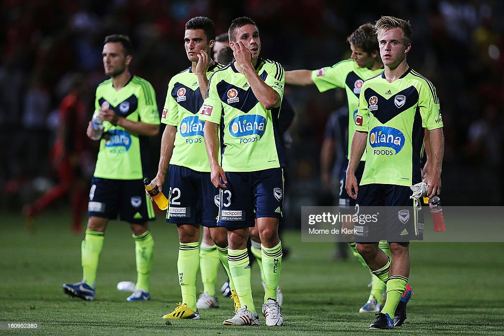 Melbourne players react after the round 20 A-League match between Adelaide United and the Melbourne Victory at Hindmarsh Stadium on February 8, 2013 in Adelaide, Australia.