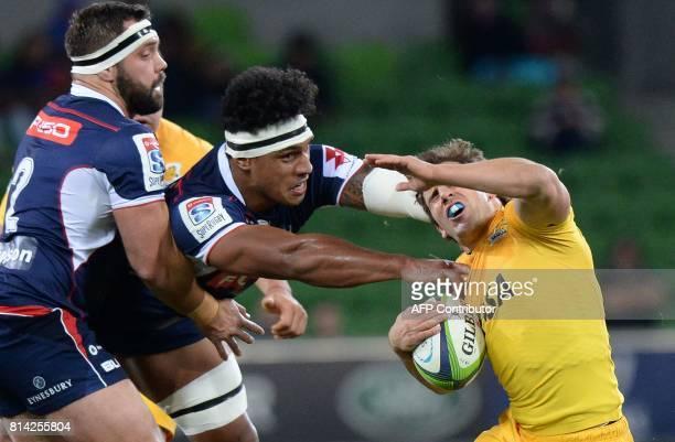 Melbourne Rebels hooker James Hanson and right lock Lopeti Timani tackle Argentina Jaguares flyhalf Nicolas Sanchez during the Super Rugby match...