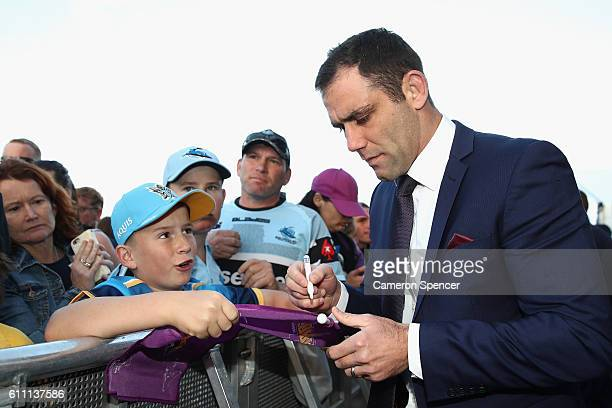 Melbourne Storm captain Cameron Smith signs autographs during the NRL Grand Final Fan Day at Sydney Opera House on September 29 2016 in Sydney...