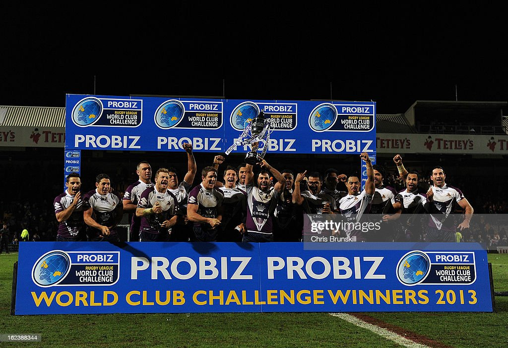Melbourne Storm celebrate with the trophy following the World Club Challenge match between Leeds Rhinos and Melbourne Storm at Headingley Carnegie Stadium on February 22, 2013 in Leeds, England.