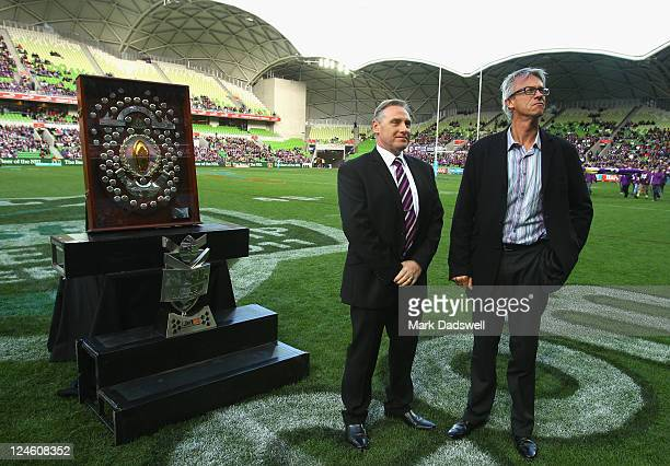 Melbourne Storm Club CEO Ron Gauci and David Gallop the Chief Executive Officer of the NRL await the presentation of the J J Giltenan Shield received...