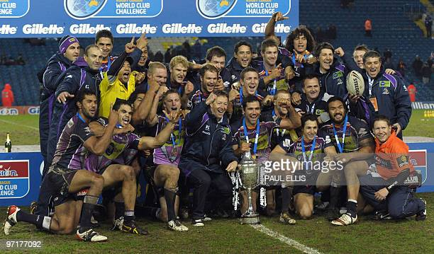 Melbourne Storm coach Craig Bellamy and captain Cooper Cronk celebrate with the team beating Leeds Rhinos in the Rugby League World Club Challenge at...