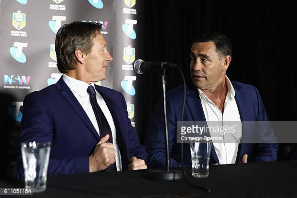 Melbourne Storm coach Craig Bellamy talks to Cronulla Sharks coach Shane Flanagan during the media during the NRL Grand Final press conference at...