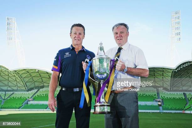 Melbourne Storm Head Coach Craig Bellamy and Leeds Rhino's CEO Gary Hetherington pose with the World Club Challenge Trophy during a Melbourne Storm...