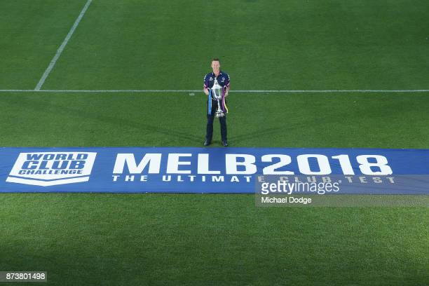 Melbourne Storm Head Coach Craig Bellamy poses with the World Club Challenge Trophy during a Melbourne Storm NRL media announcement at AAMI Park on...