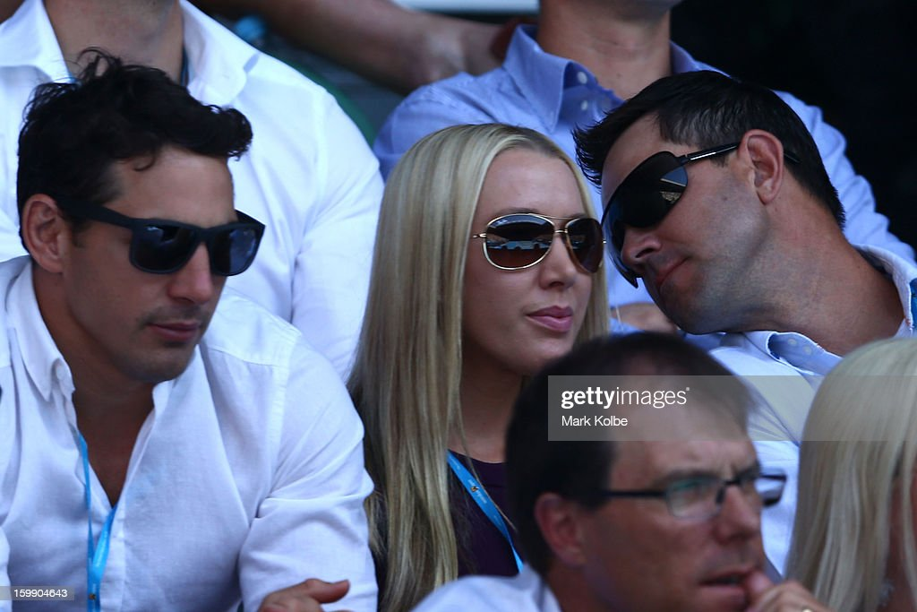 Melbourne Storm NRL player Billy Slater (L), former Australian cricketer Ricky Ponting (R) and his wife Rihanna watch the Quarterfinal match between Serena Williams of the United States of America Sloane Stephens of the United States of America during day ten of the 2013 Australian Open at Melbourne Park on January 23, 2013 in Melbourne, Australia.