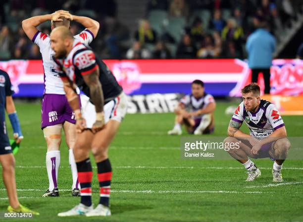Melbourne Storm players look on dejected after the final whistle during the round 16 NRL match between the Sydney Roosters and the Melbourne Storm at...