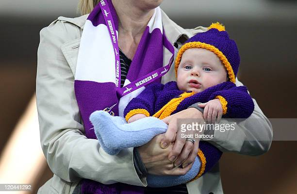 Melbourne Storm supporter holds her baby during the round 22 NRL match between the Melbourne Storm and the Penrith Panthers at AAMI Park on August 6...