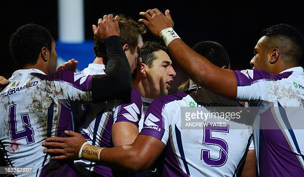 Melbourne Storm's Billy Slater celebrates after scoring a try during the Rugby League World Club Challenge between Leeds Rhinos and Melbourne Storm...