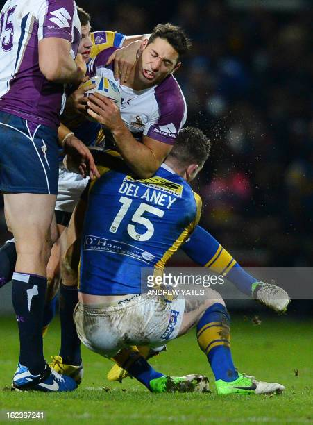 Melbourne Storm's Billy Slater is tackled by Leeds Rhino's Brett Delaney during the Rugby League World Club Challenge between Leeds Rhinos and...