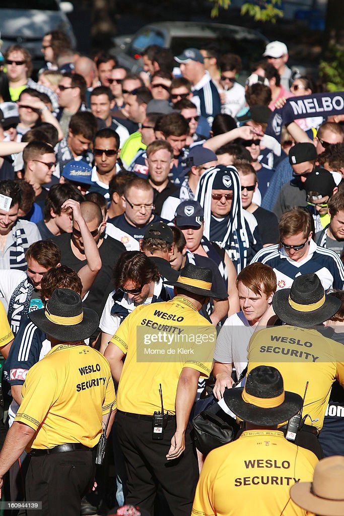 Melbourne supporters are searched by security as arrive at Hindmarsh Stadium before the round 20 A-League match between Adelaide United and the Melbourne Victory at Hindmarsh Stadium on February 8, 2013 in Adelaide, Australia.