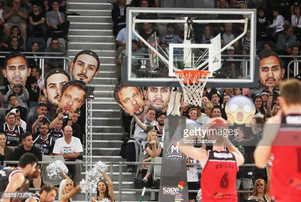 Melbourne United supporters in the crowd try to distract Andrew Ogilvy of the Hawks as he shoots a free throw during the round 18 NBL match between...