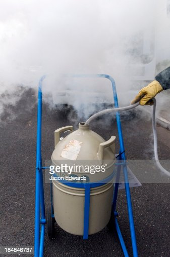 Liquid nitrogen is loaded into a vacuum flask for transportation.