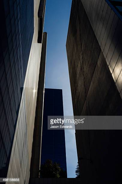 An alley between a pair of concrete and glass office towers in the CBD.