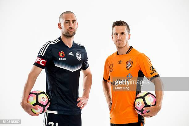 Melbourne Victory captain Carl Valeri and Brisbane Roar captain Matt McKay pose during the 2016/17 ALeague Season Launch at ANZ Stadium on October 4...