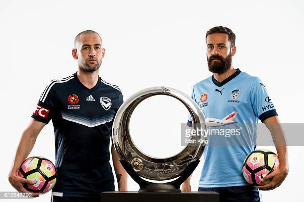 Melbourne Victory captain Carl Valeri and Sydney FC captain Alex Brosque pose during the 2016/17 ALeague Season Launch at ANZ Stadium on October 4...