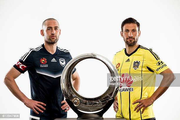 Melbourne Victory captain Carl Valeri and Wellington Phoenix captain Andrew Durante pose during the 2016/17 ALeague Season Launch at ANZ Stadium on...