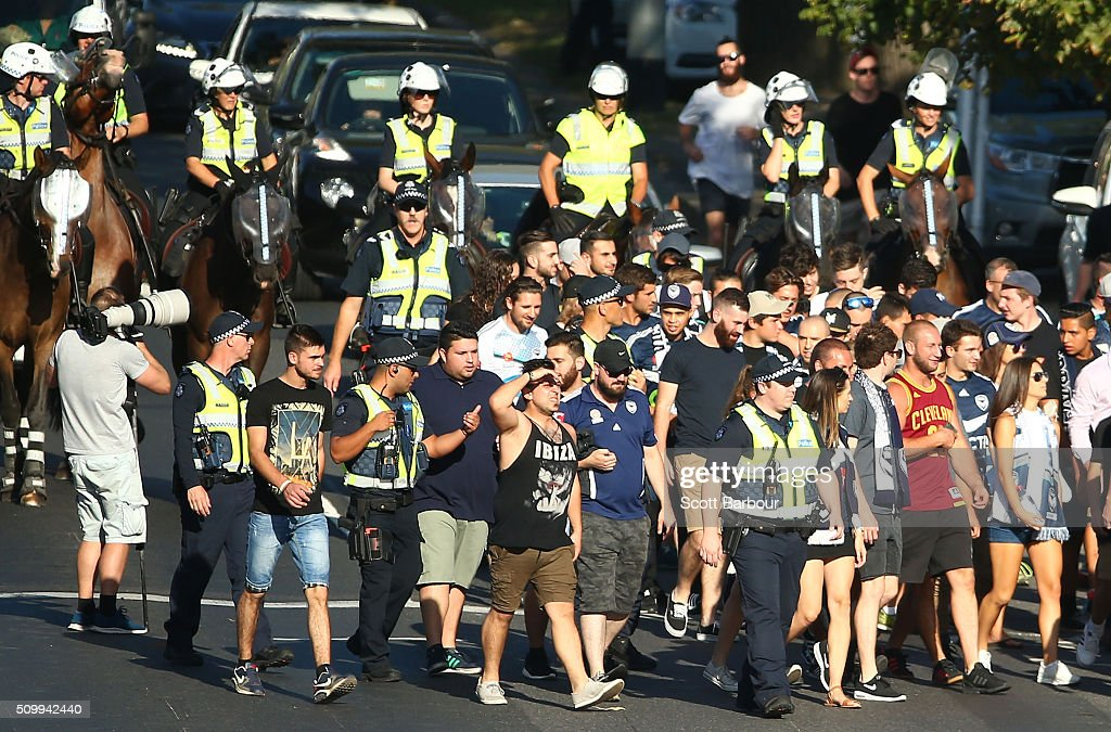 Melbourne Victory fans are followed by police officers on horseback as they arrive at the ground during the round 19 A-League match between Melbourne City FC and Melbourne Victory at AAMI Park on February 13, 2016 in Melbourne, Australia.