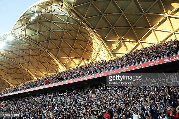 Melbourne Victory fans celebrate a goal during the 2015 ALeague Grand Final match between the Melbourne Victory and Sydney FC at AAMI Park on May 17...