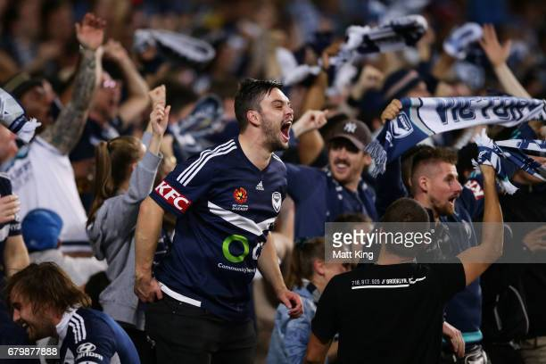Melbourne Victory fans celebrate the first goal to Besart Berisha of Melbourne Victory during the 2017 ALeague Grand Final match between Sydney FC...