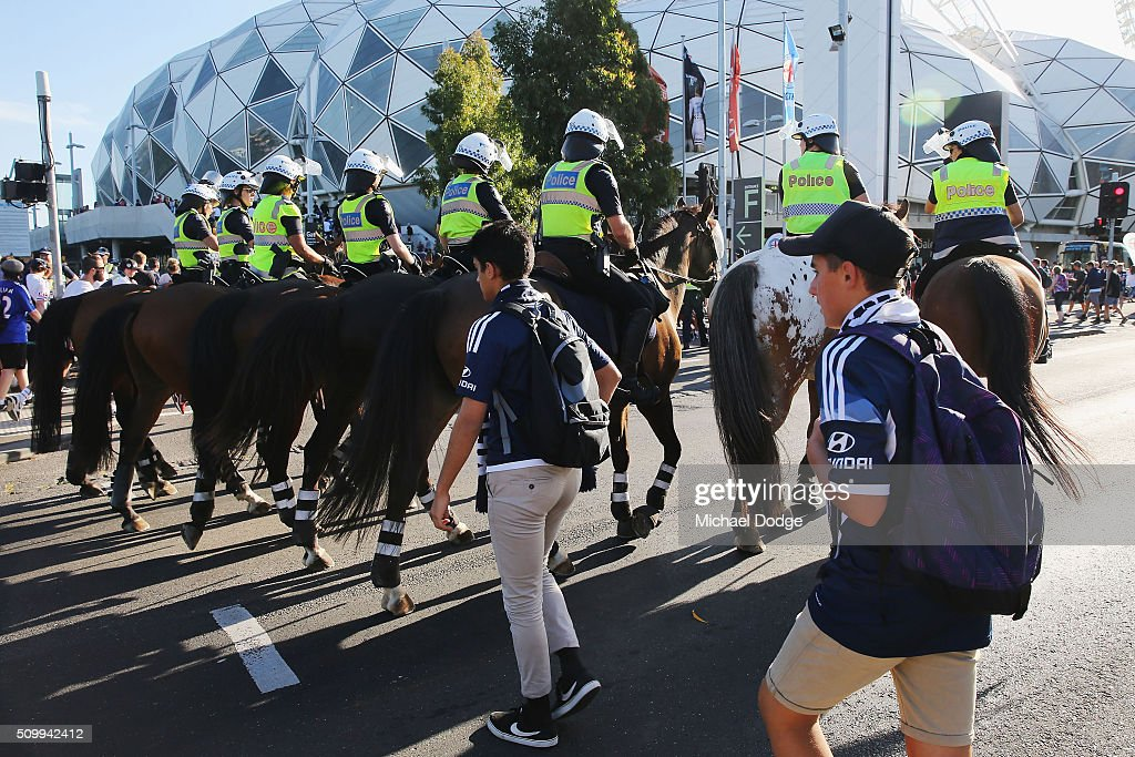 Melbourne Victory fans, followed by police on horseback, arrive down City Rd for the round 19 A-League match between Melbourne City FC and Melbourne Victory at AAMI Park on February 13, 2016 in Melbourne, Australia.