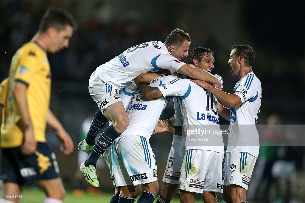 Melbourne Victory players celebrate a goal during the round 10 ALeague match between the Central Coast and the Melbourne Victory at North Sydney Oval...