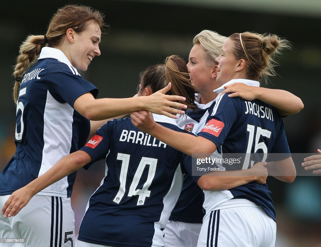 Melbourne Victory players celebrate a goal during the round 12 W-League match between the Newcastle Jets and the Melbourne Victory at Wanderers Oval on January 13, 2013 in Newcastle, Australia.