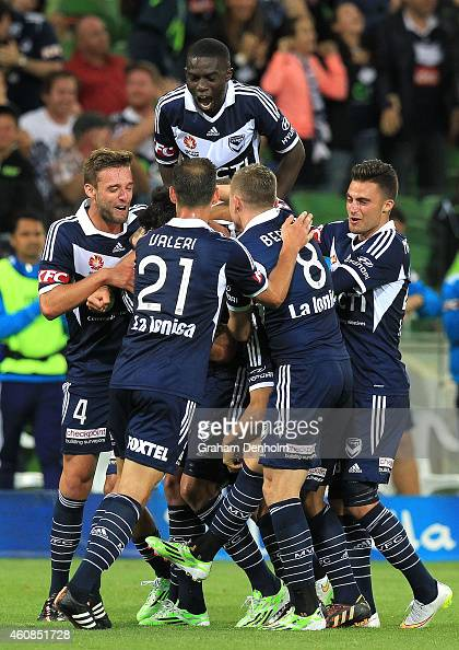 Melbourne Victory players celebrate the goal by Gui Finkler of Melbourne Victory during the round 13 ALeague match between the Melbourne Victory and...