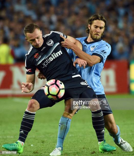 Melbourne Victory's Besart Berisha fights for the ball with Sydney FC's Joshua Brillante during the 2017 ALeague Grand Final match at Allianz Stadium...