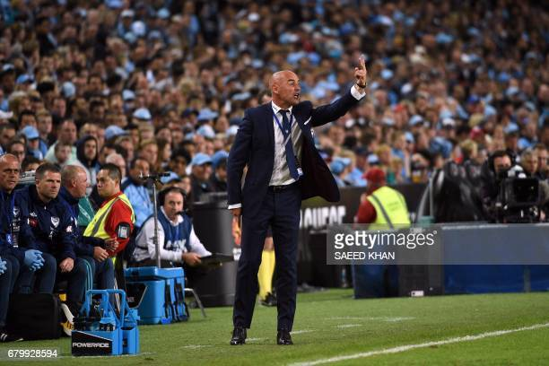 Melbourne Victory's coach Kevin Muscat gives instructions to his players during extratime against Sydney FC in the 2017 ALeague Grand Final football...